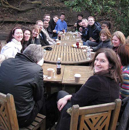 A photo of a group of people enjoying a drink outdoors