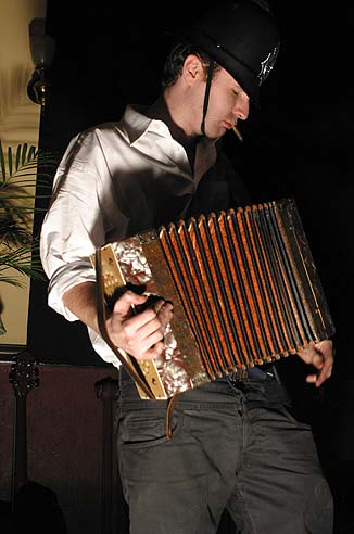 A photo of a man playing an accordion