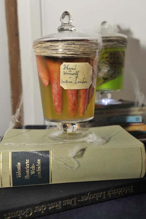A photo of a hairy hand in a specimen jar