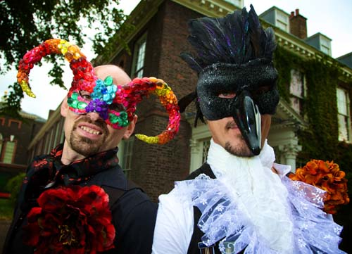 A photo of two men in costumes and masks