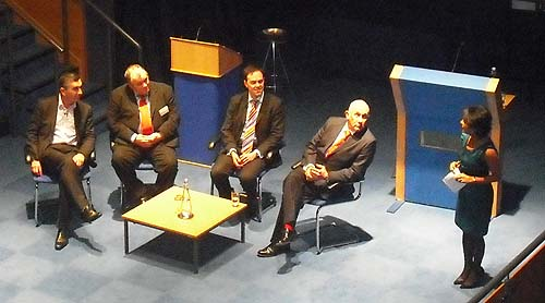 A photo of a panel of speakers