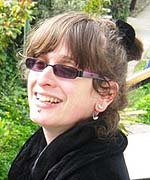 a photo of a woman wearing sunglasses