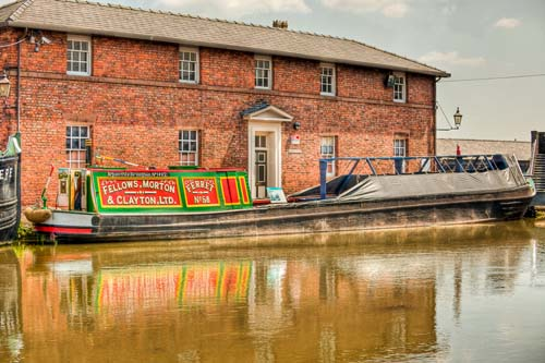 A barge moored by an old industrial building