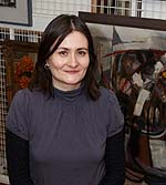 A woman in a painting storeroom