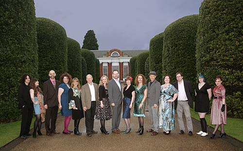A photo of a line of people in a formal garden