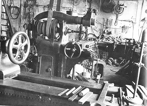 A black and white photo of factory machinery