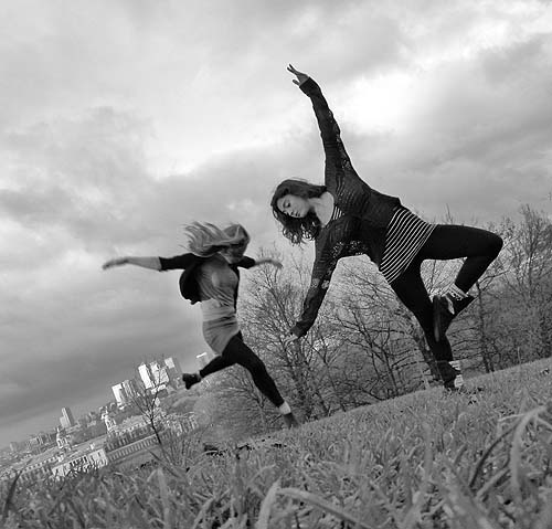 Two girls dancing outdoors
