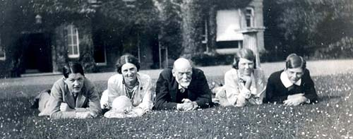 Five Victorians lying down on a grass lawn