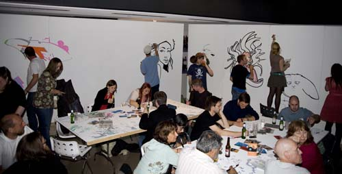 A group of people drink beer and draw on white wall panels