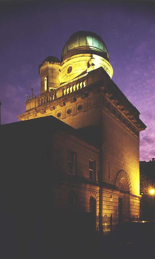 An impressive observatory building with a dome, seen at twilight