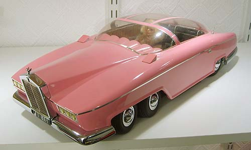 A pastel pink retro toy car