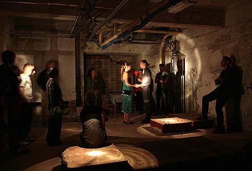 People performing in a dimly lit space