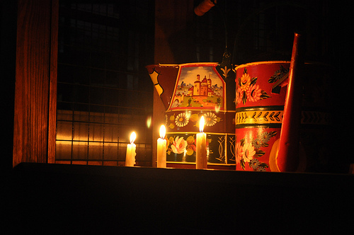 Traditionally painted canal art lit by candles