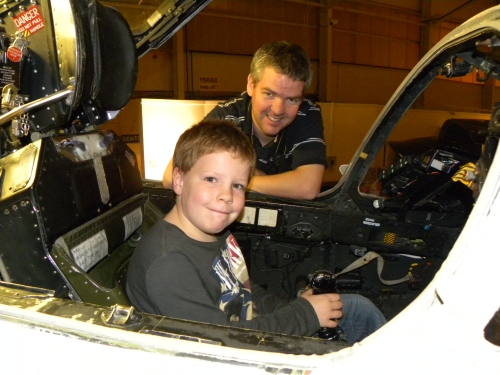 A father and son in an aeroplane cockpit