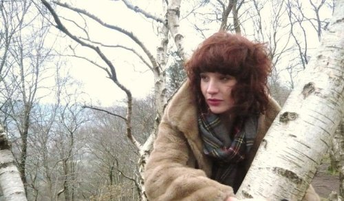 A photo of a woman in a tree