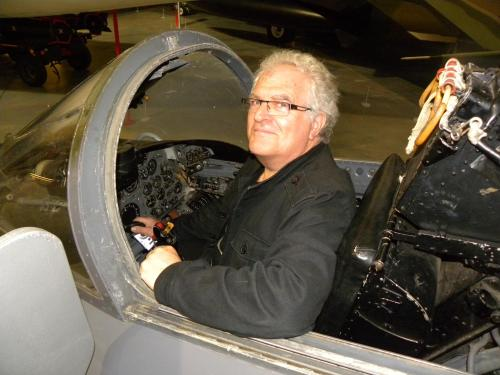 A man sitting in an aeroplane cockpit