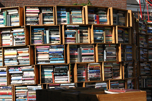 Hundreds of books, stacked in wine crates