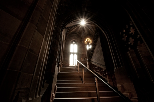 A darkened staircase at dusk