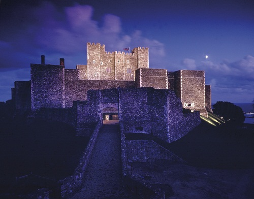 An impressive stone castle at night