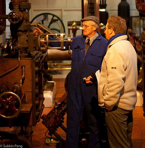 Two men looking at en engine