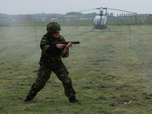 A soldier with a helicopter