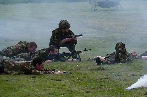 Reenactors playing British soldiers with guns