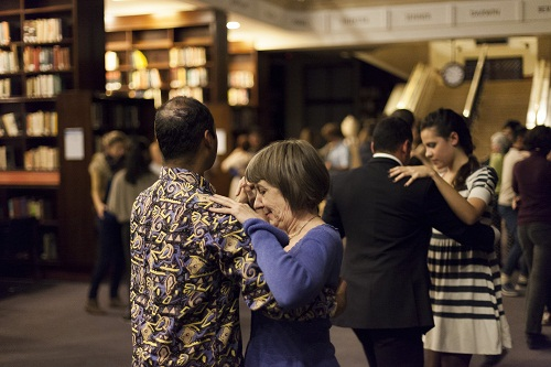 couples dancing slowly in a museum after dark