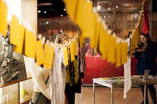 bright yellow artworks hanging from clotheslines