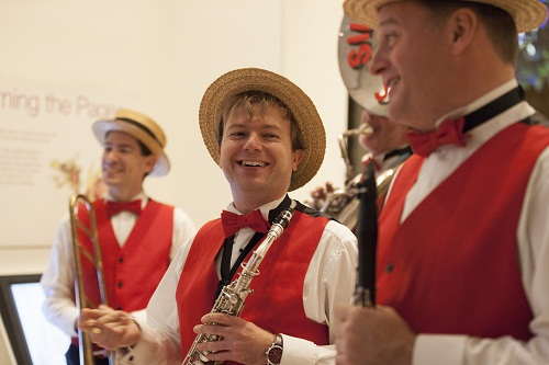 a band in red waistcoats and bow ties