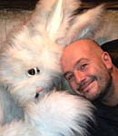 Two men, one wearing a rabbit suit
