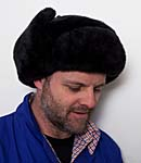 A man wearing a large Russian furry hat