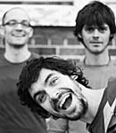 black and white photo of three men smiling