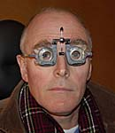A man wearing opticians' measuring glasses