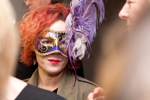 Woman in masquerade mask.