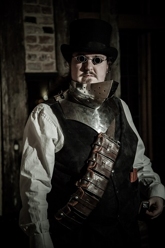 A man wearing a steampunk outfit and dark glasses