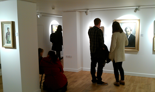 People looking at artwork in a gallery