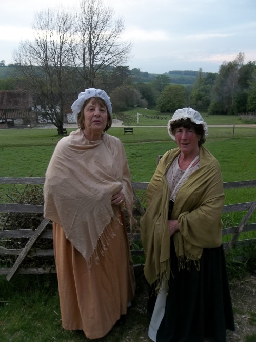 Two women in historic dress.