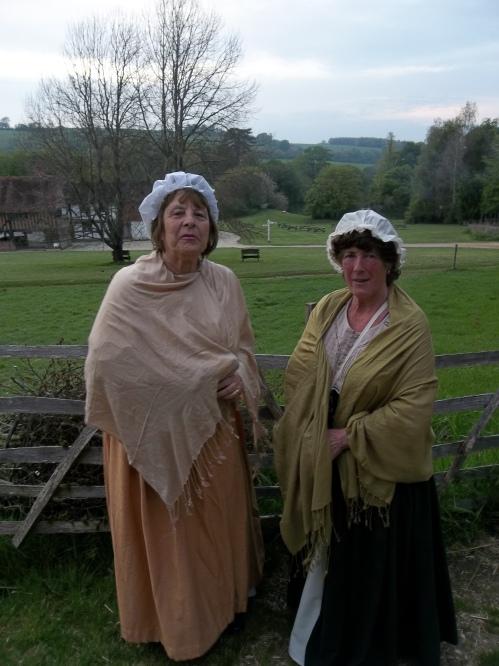Two women in historic dress.