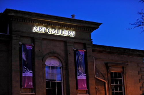 Exterior photo of an art gallery at night