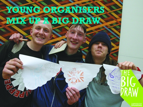 young men holding up drawings