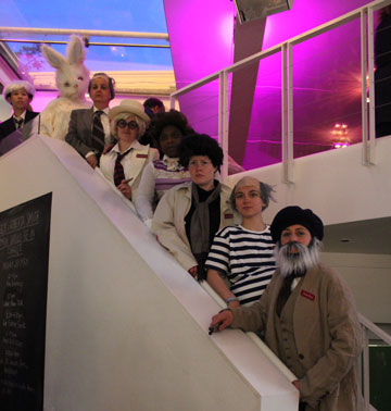 A group of people on a staircase dressed up as modern artists