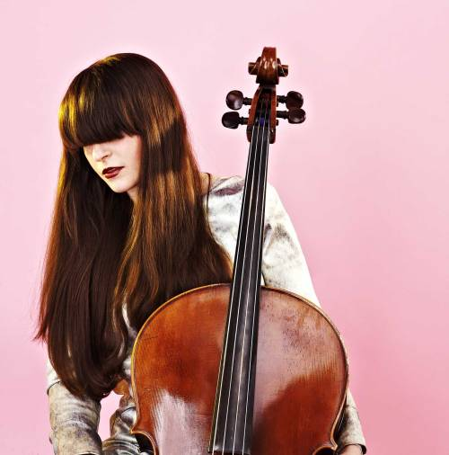 A woman with long hair and a cello