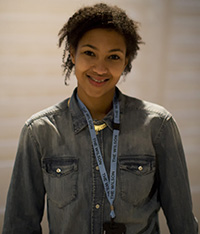 A woman in a denim jacket smiling