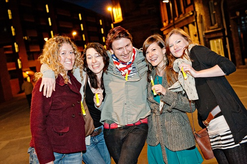 5 young people on a night out with glow sticks