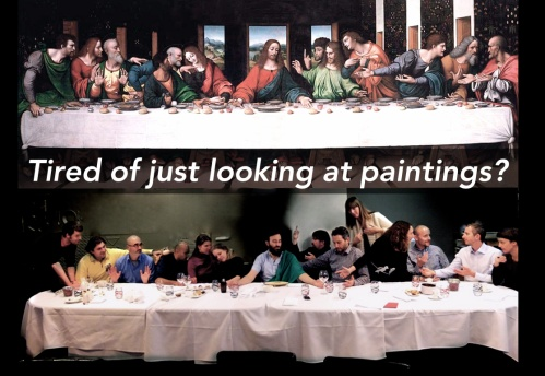 A group of people recreating a Last Supper painting