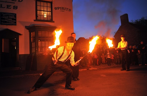 costumed fire jugglers in a historic street