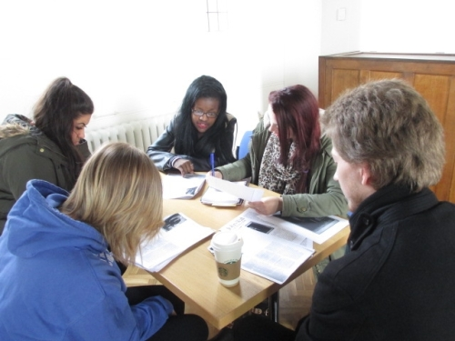 A group of students working around a table