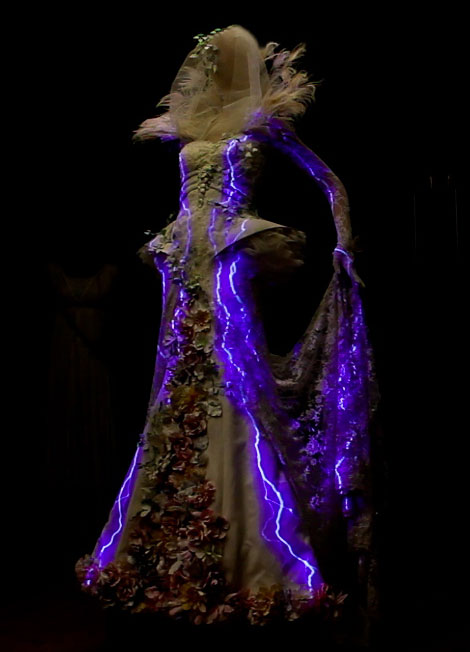 A glowing dress in darkness