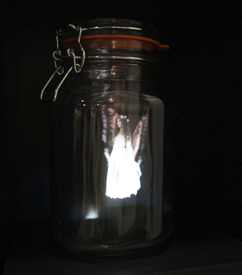 A glowing fairy in a Mason jar