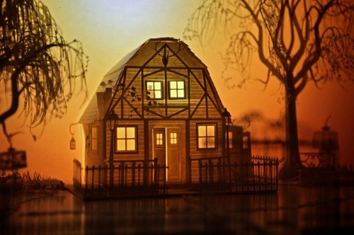 a glowing paper house
